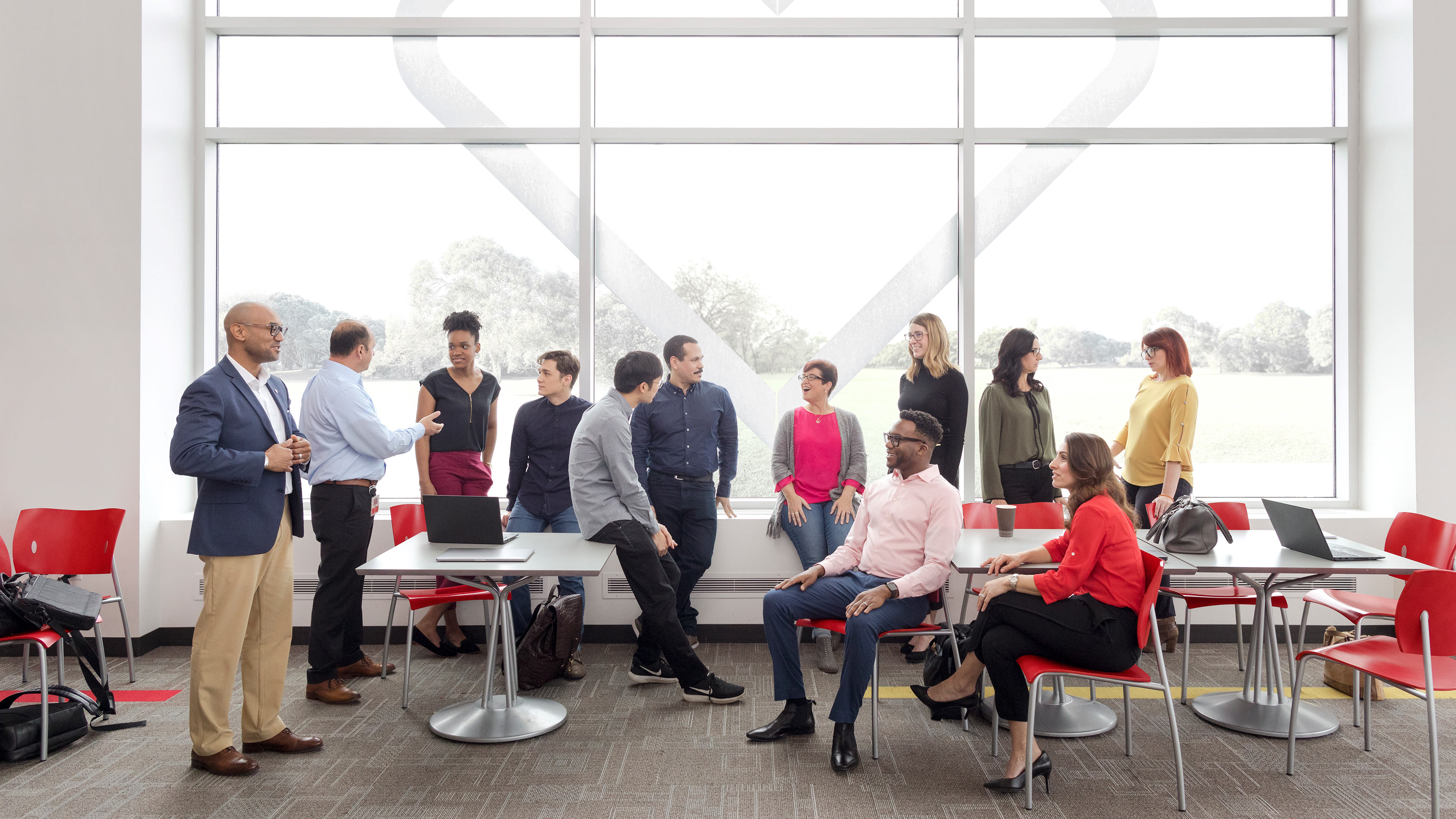 A dozen CVS Health employees, all from different backgrounds and jobs, gather in the cafeteria at the company's headquarters in Woonsocket, Rhode Island.