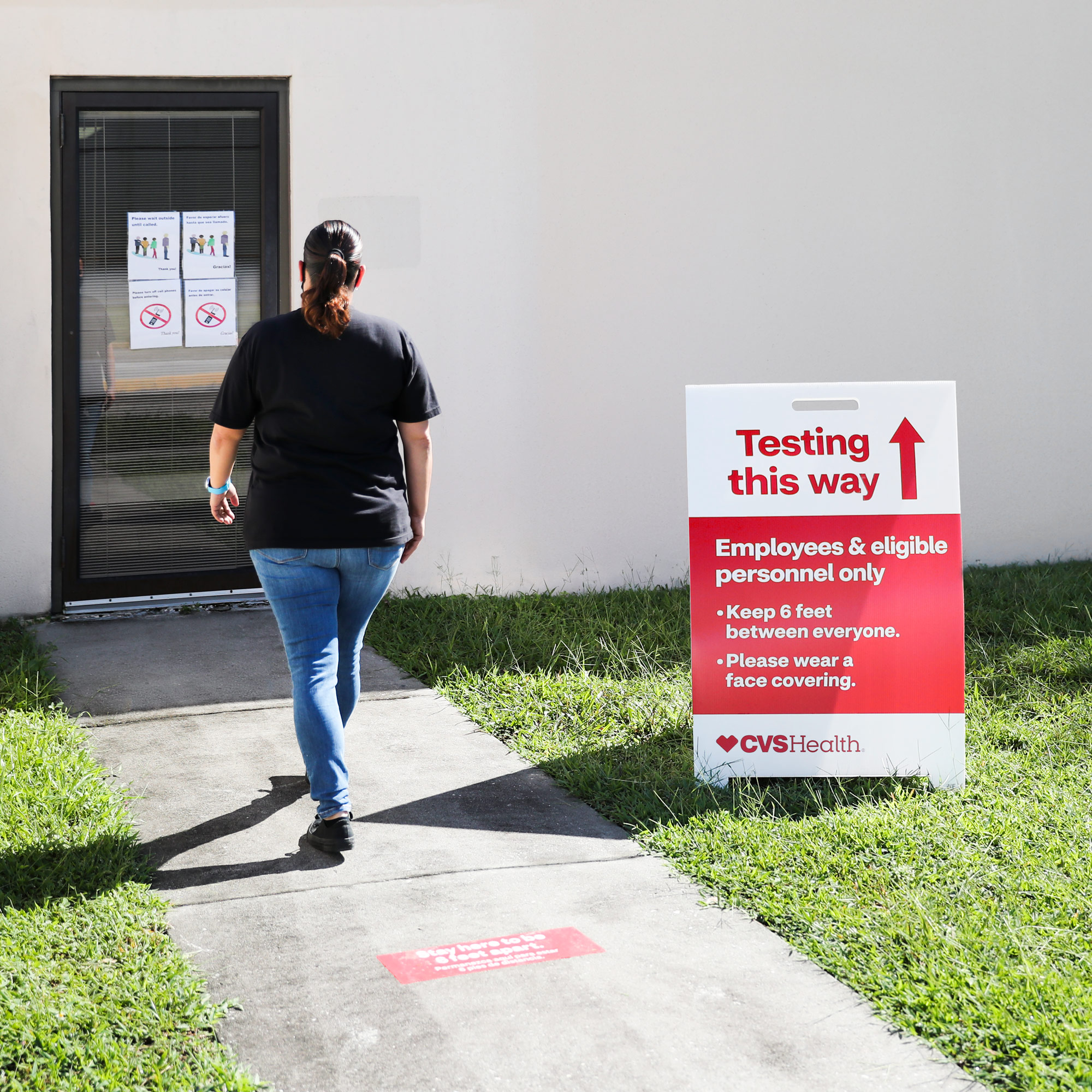 A person walks up to a CVS Health COVID-19 testing location.