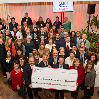 CVS Health employees presenting a large cheque on behalf of the CVS Health Charity Classic.