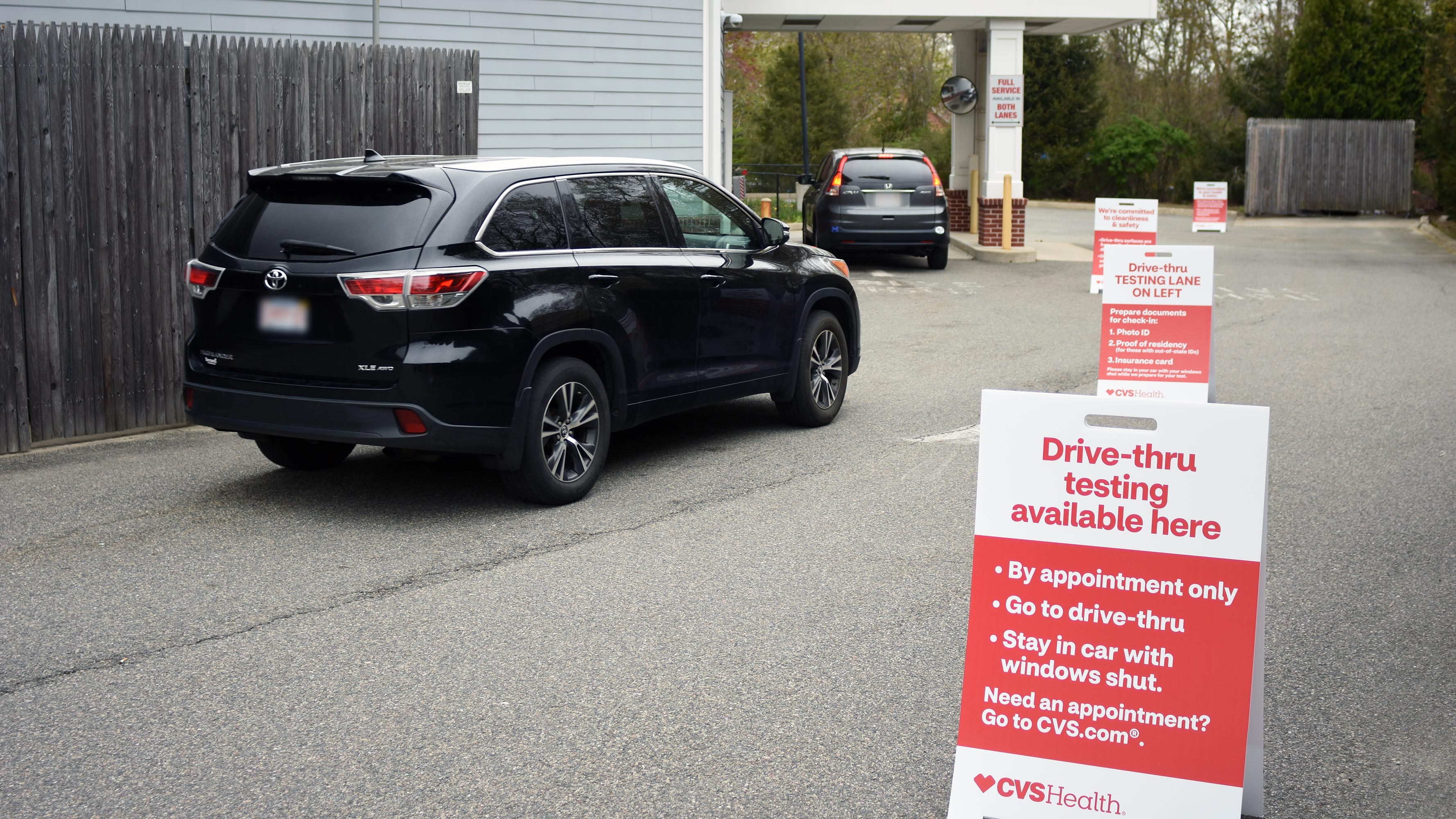 Cars in queue at a CVS Pharmacy drive-thru location, waiting to take the expanded self-swab COVID-19 test. (Available at certain locations.)