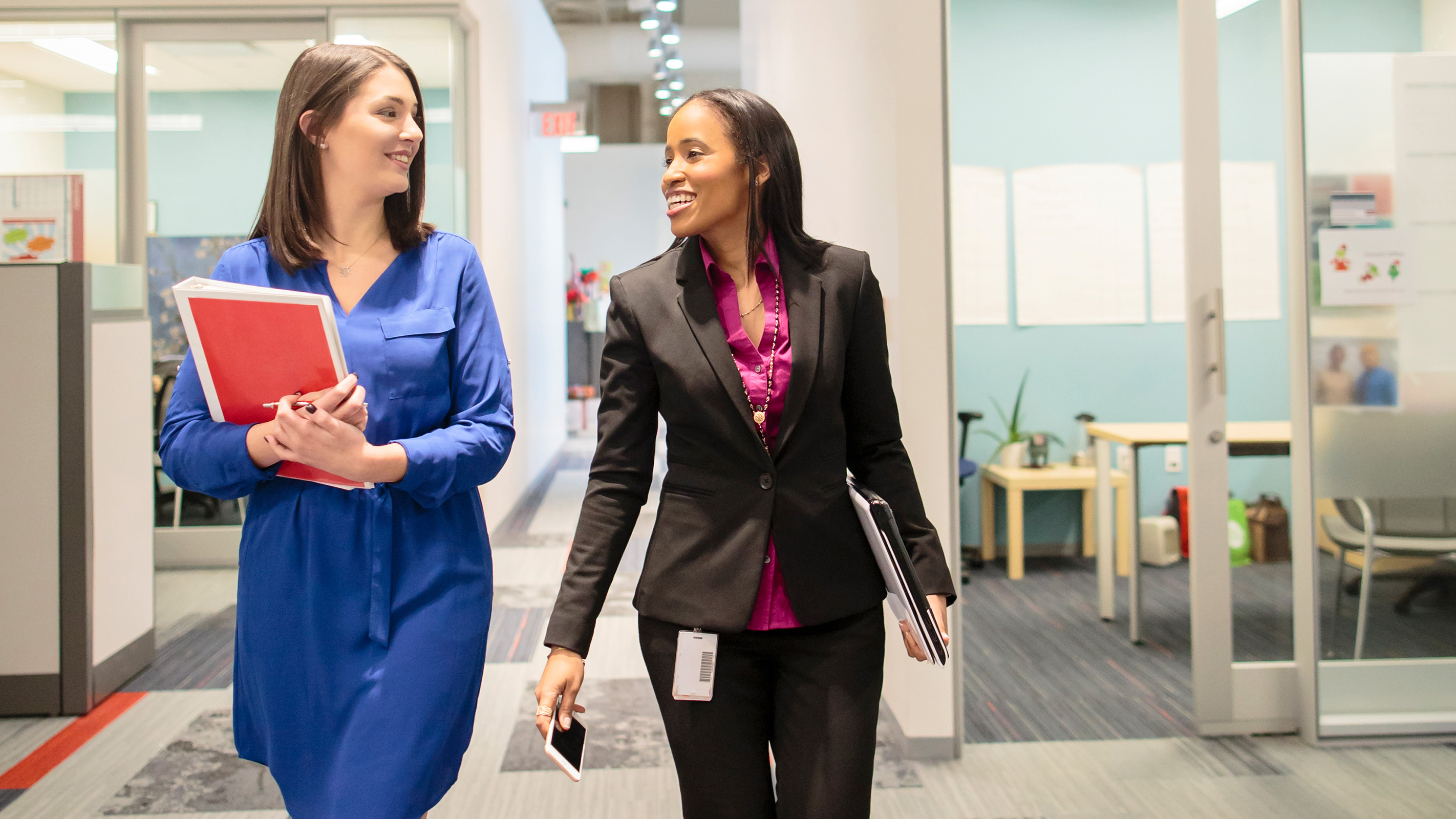 Two CVS Health colleagues walking down a corridor.