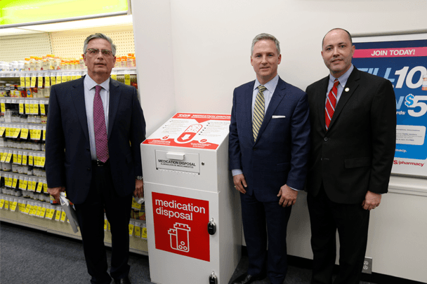 Photo of participants: Division VP of CVS Pharmacy Brian Bosnic, Georgia State Senator John F. Kennedy and Georgia AG Chris Carr