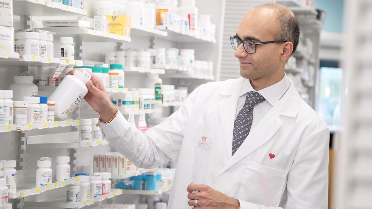 A photo of Saurabh Mistry behind the pharmacy counter.