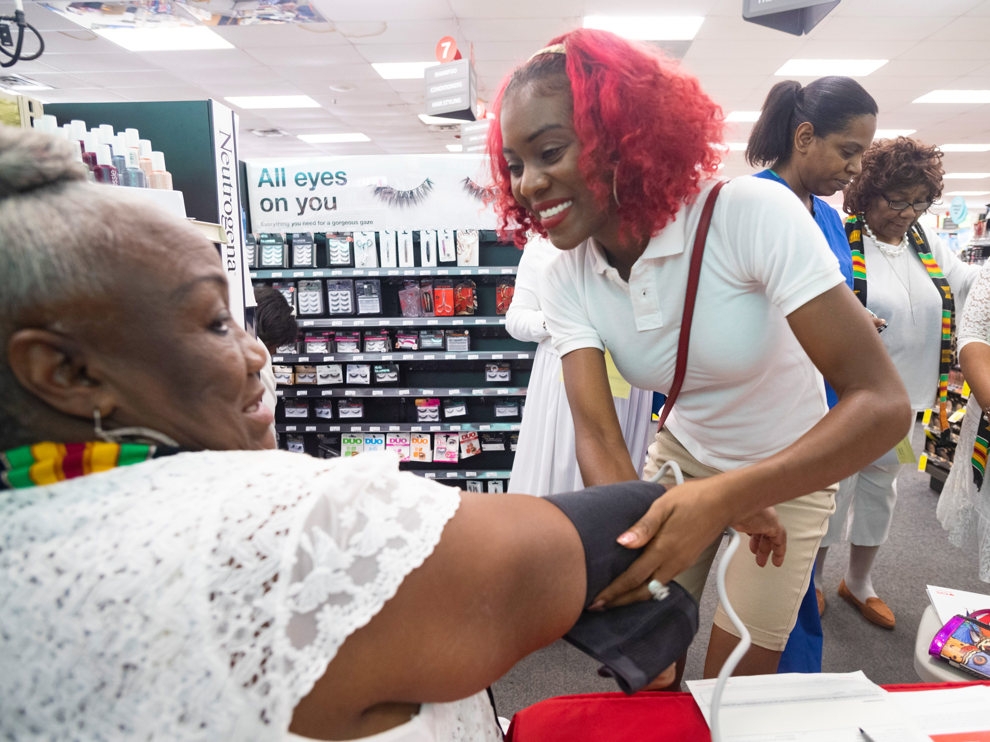 A customer receives a free health screening.