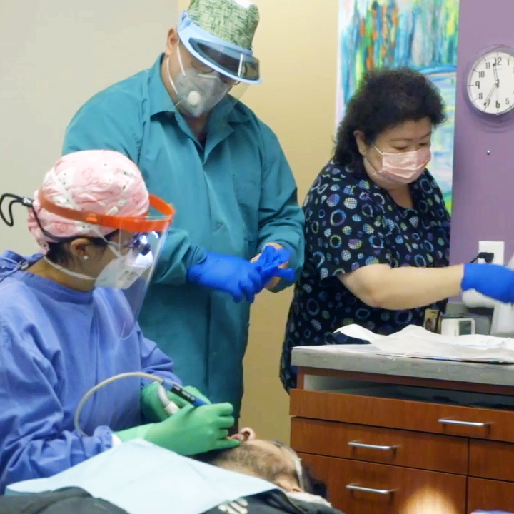 A team of dental professionals working on a patient, part of the outreach of the San José Clinic of Houston, Texas.