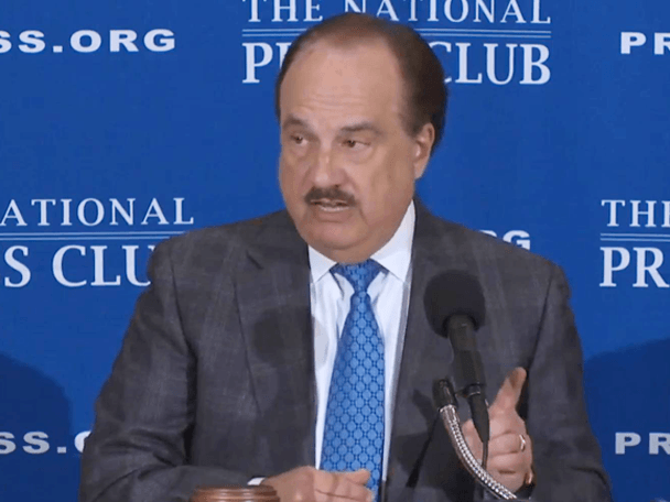 Larry Merlo speaking at National Press Club.