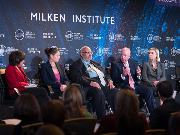 Health experts hold a panel discussion at the Milken Institute.