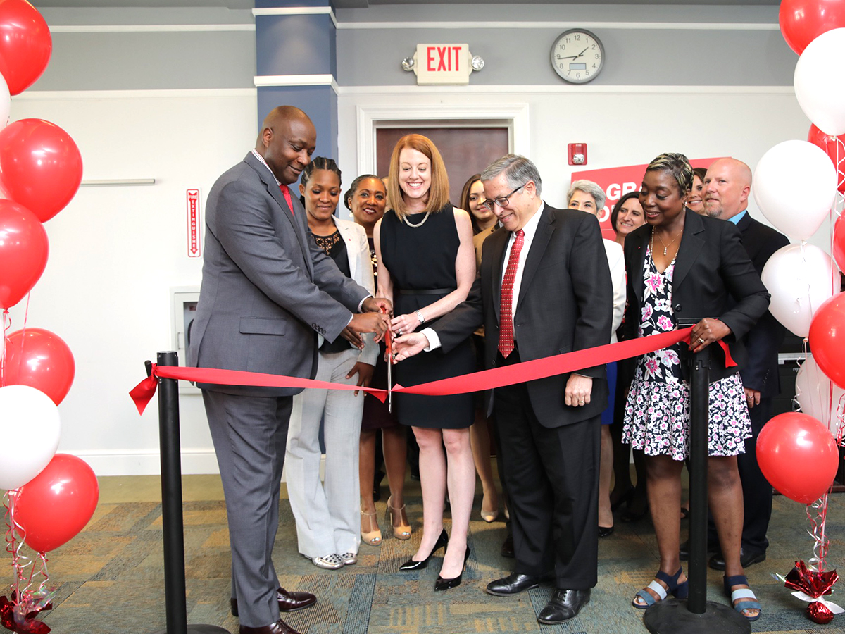 A group of people cut the ribbon at the Workforce Innovation and Talent Center in Cleveland.