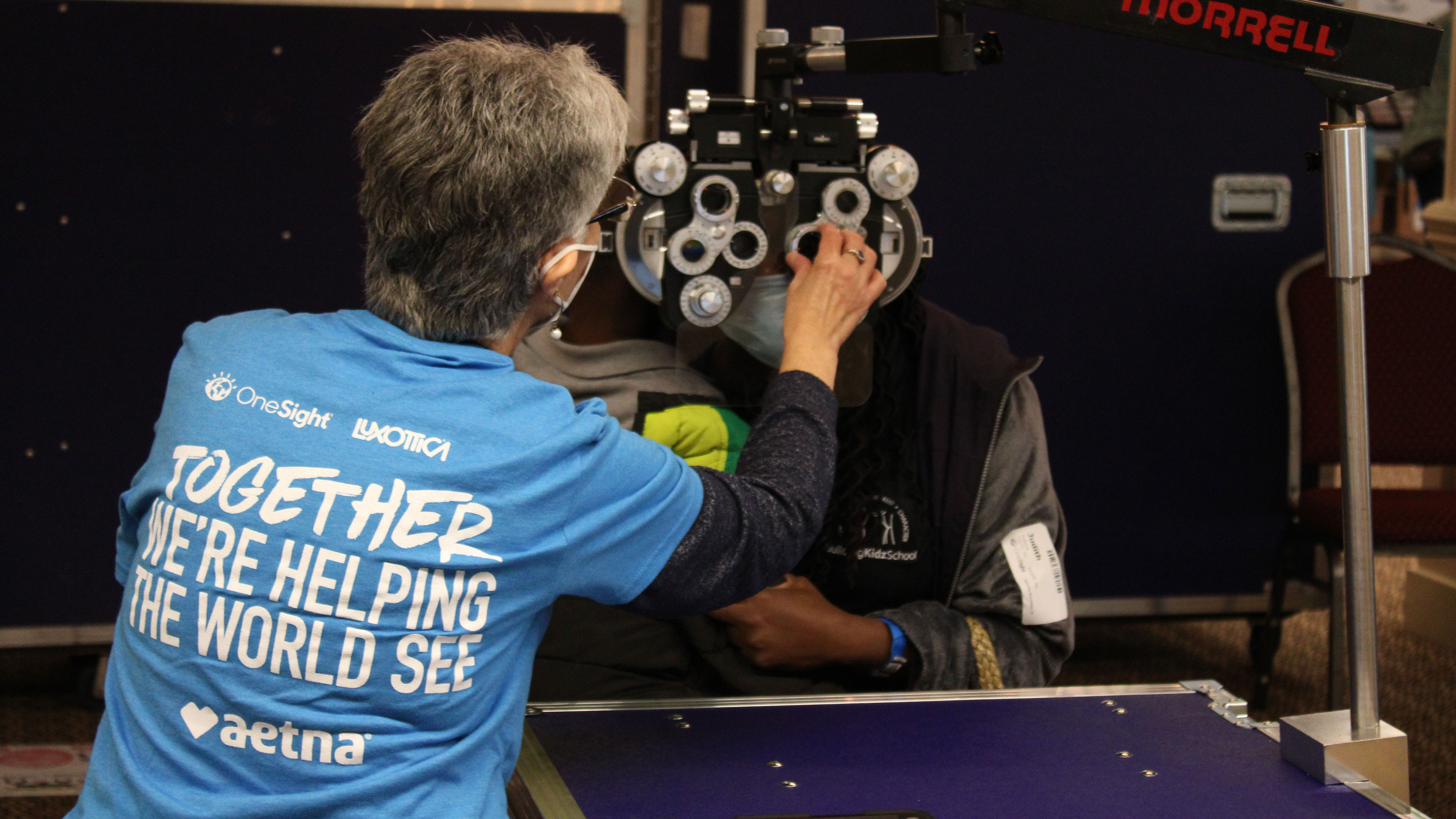 A North Atlanta resident receives an eye exam during a free clinic.