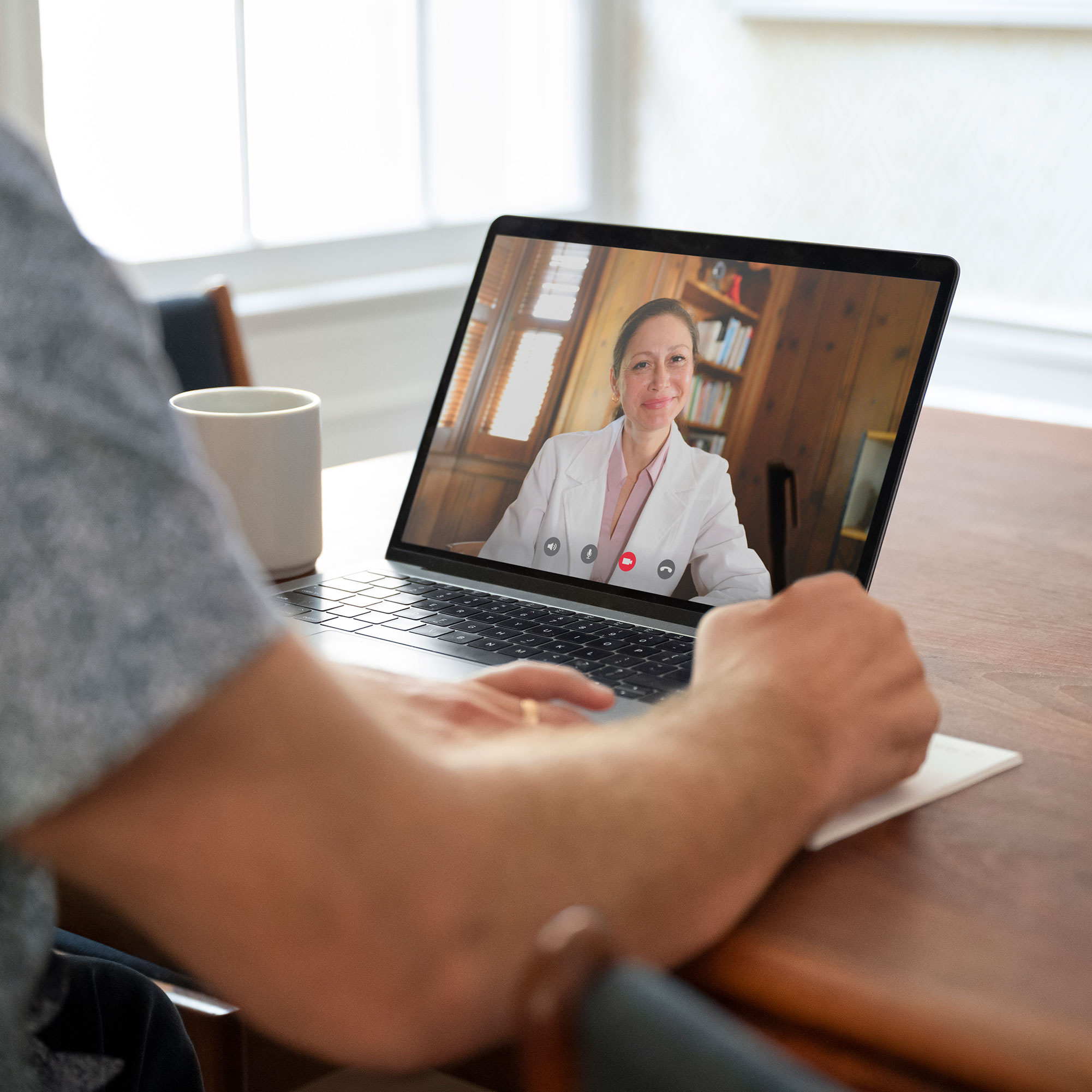 Patient uses virtual care via their laptop to meet with a physician.
