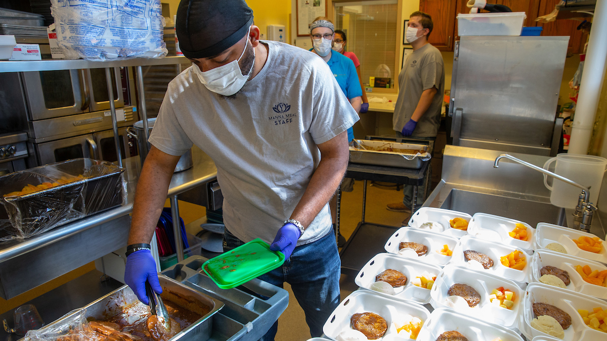 Non-profit soup kitchen Manna Meal, a partner of Unite Us, prepares to serve meals June 4, 2020, in Charleston, West Virginia.