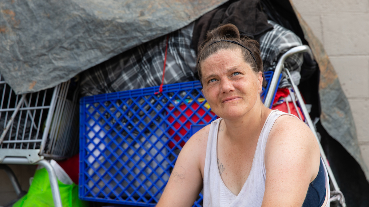 Amanda sits in the parking lot outside the United Way Drop-in Peer Center in Charleston, West Virginia.