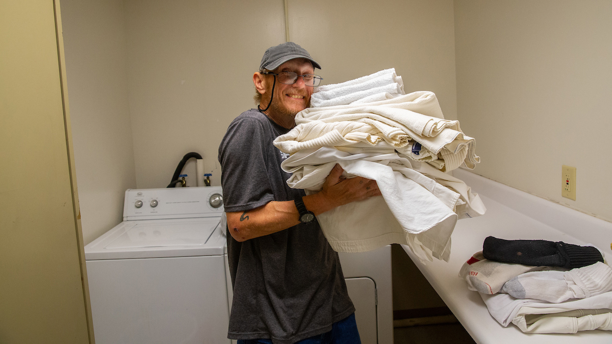 William Turley does his laundry inside the Peer Center (a drop-in center for individuals experiencing homelessness) in Charleston, West Virginia.