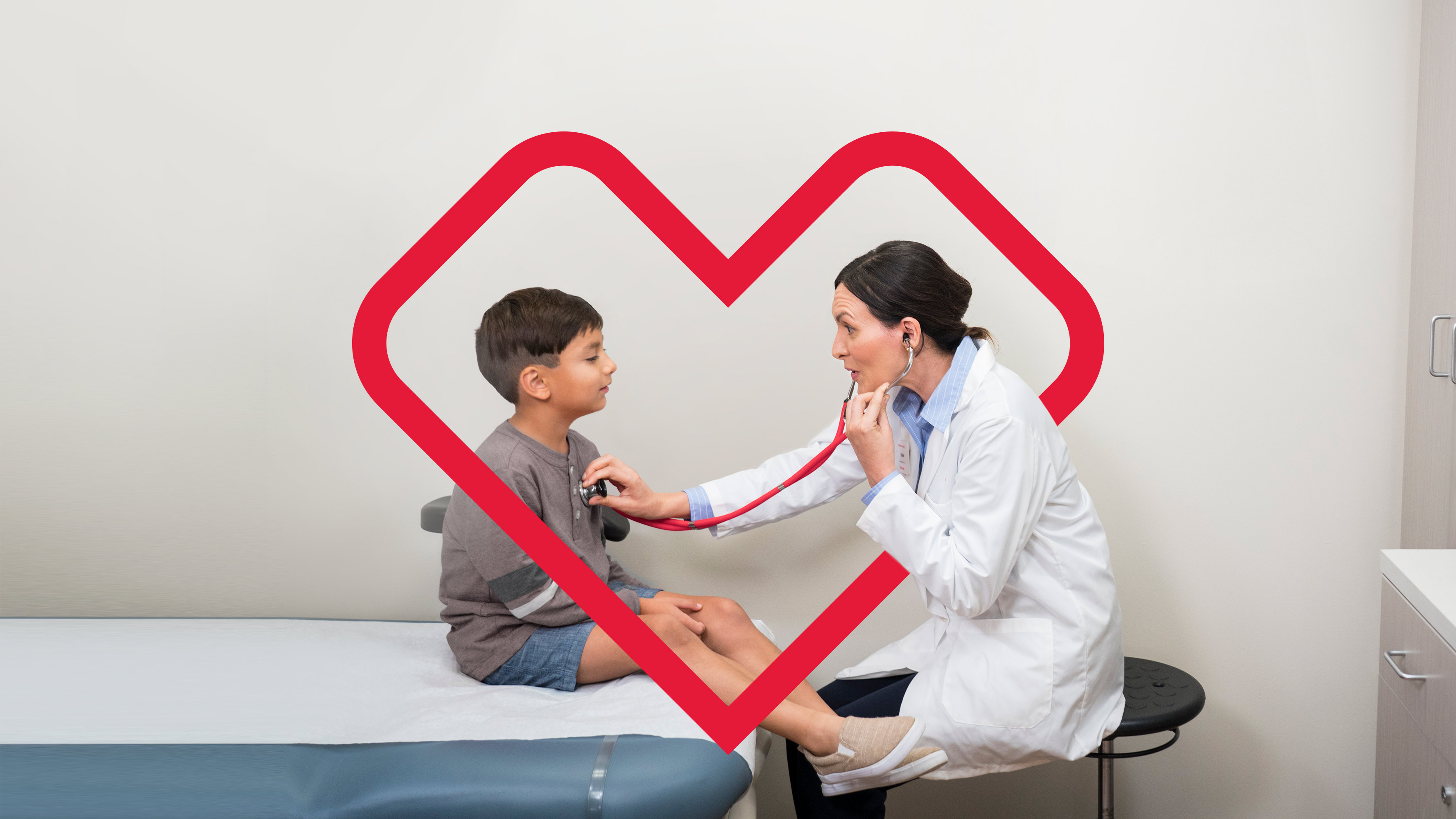 A MinuteClinic practitioner examines a young boy using a stethoscope inside an examination room; a red CVS Health heart outline surrounds them.