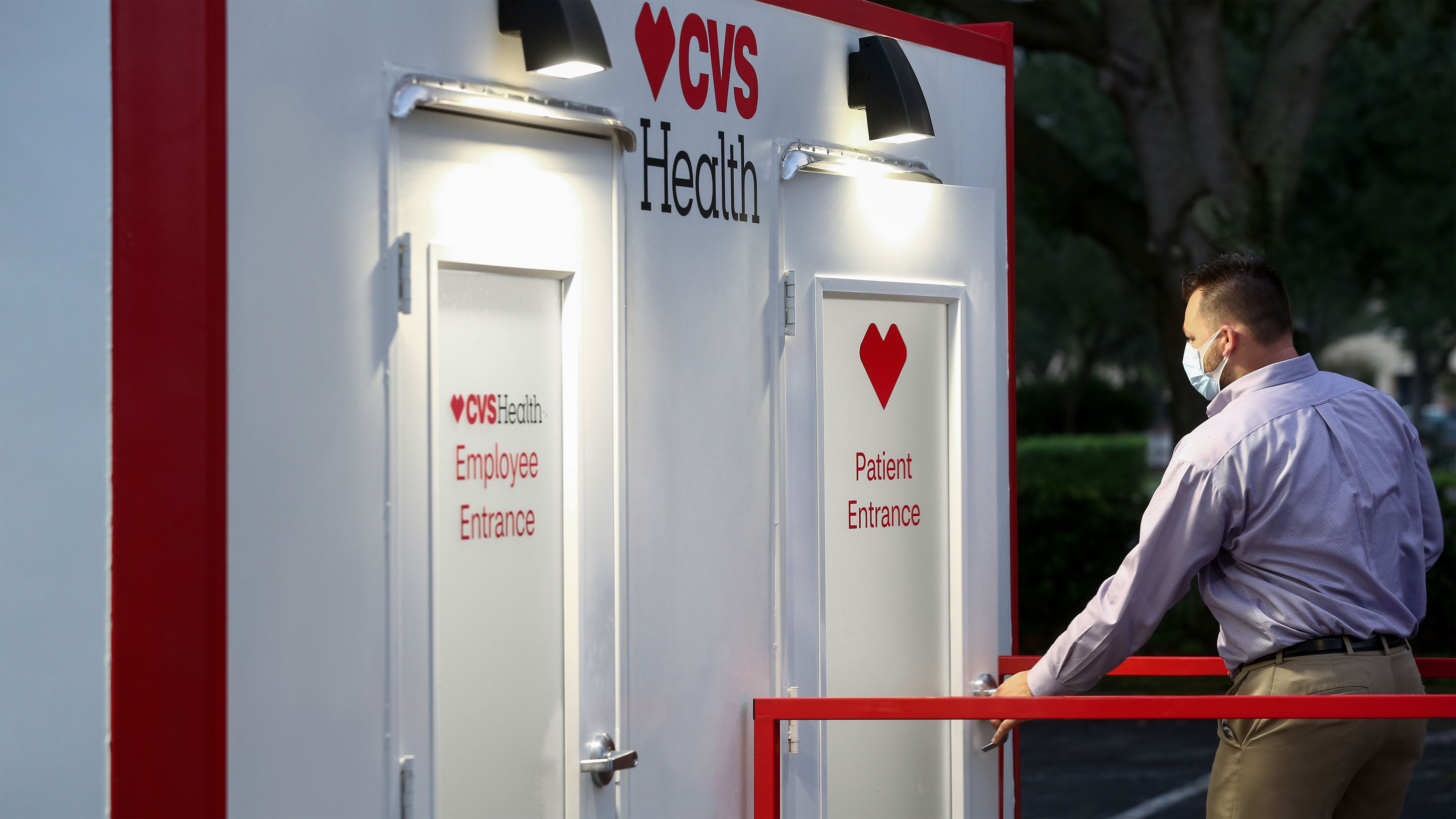 Man entering a CVS Health point of care testing site through the patient entrance of a kiosk.