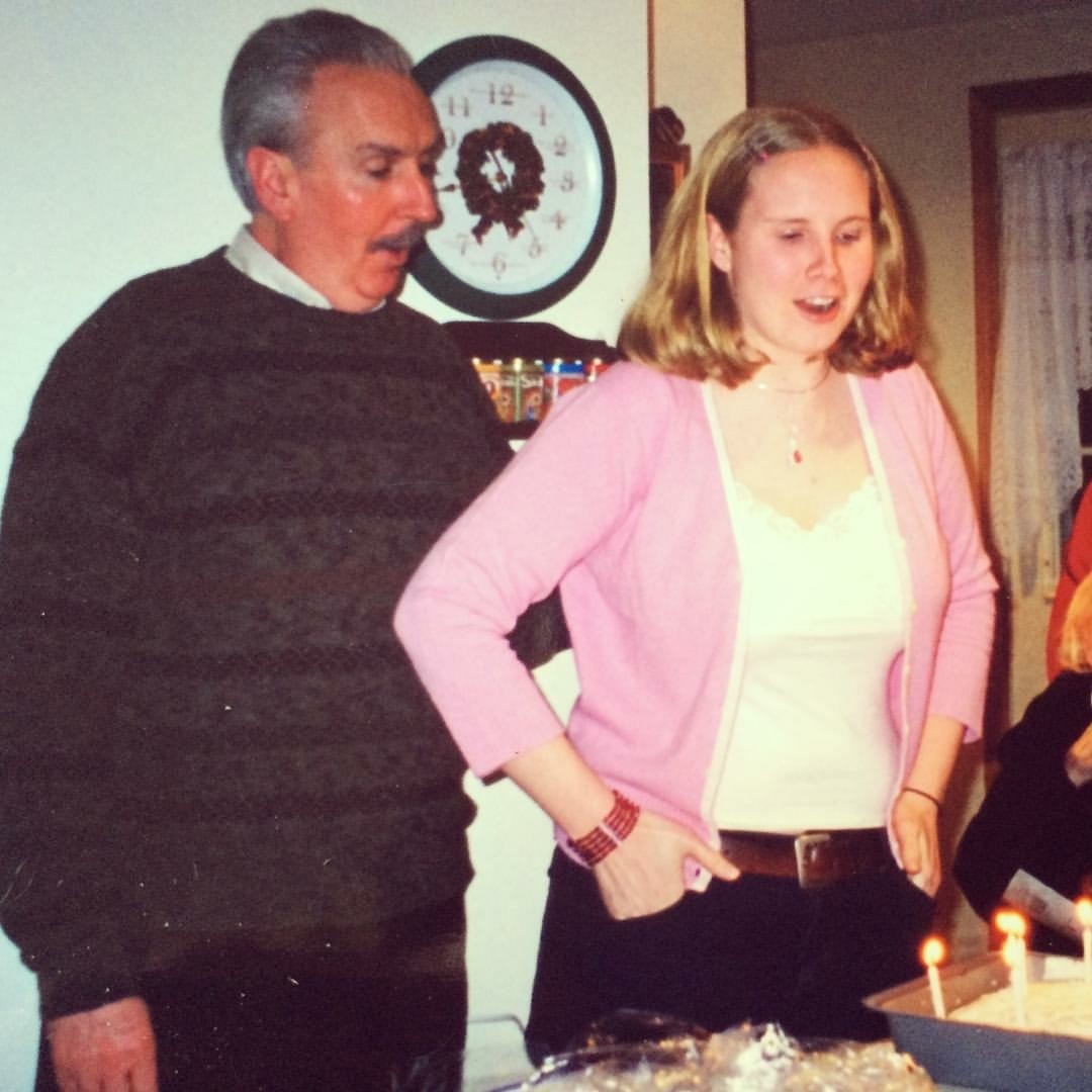 Tara and Uncle Billy celebrating their December birthdays together, 2003 looking at a birthday cake.