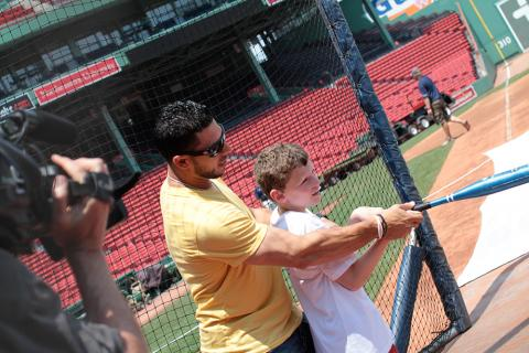 A young boy participates in the CVS Health All Kids Can Baseball Camp program