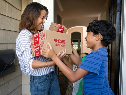 Woman and boy with CVS Pharmacy delivery.
