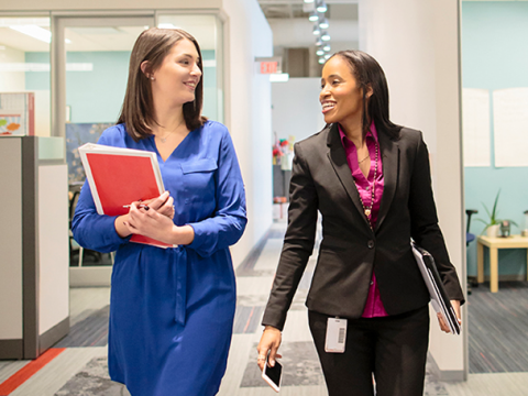 Two female CVS Health corporate colleagues walking.