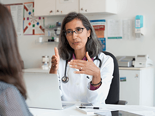 Provider consults with patient