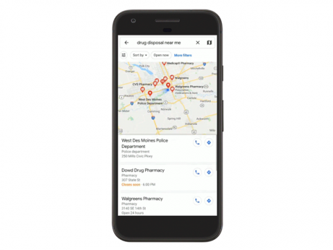 A cell phone with Google maps on the screen.