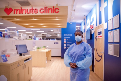 A Care concierge stands ready to help within a CVS MinuteClinic.