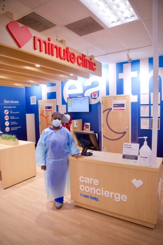 A Care concierge greets walk-ins to the CVS MinuteClinic.